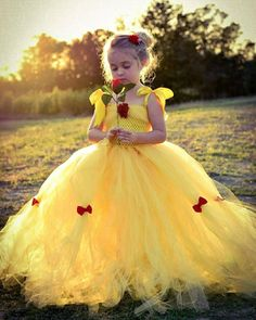 Relive a tale as old as time as Belle in our custom tea-length Belle costume. With a beautiful rose on the bodice and red bows on the gorgeous tulle skirt your little Belle is sure to be a show stopper.