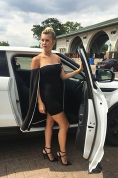 Mid thigh tube dress with a connected cape in Black.
