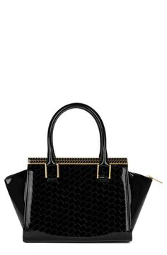 Amazing embossed tote. Love the silhouette!