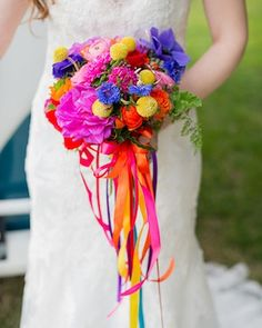 Rainbow bridal bouquet | Kelly Marie Photography | see more on: http://burnettsboards.com/2015/08/vintage-vinyl-styled-wedding/