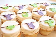 Baby shower cupcakes! Cute idea! I would need a little more jazz with the clothes line and items.