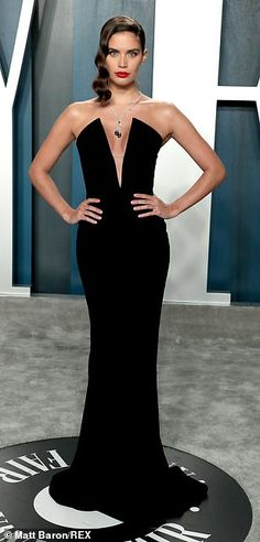 Classic: Sara Sampaio, 28, exuded old Hollywood glamour in her plunging form-fitting black...