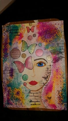 Mixed media art,  using dylusion paint and stencils & stamps from prima marketing and crafters workshop