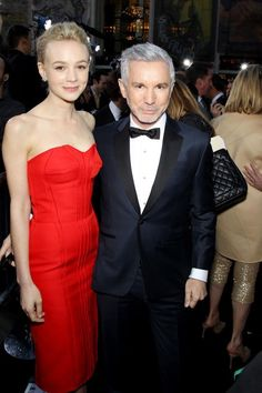 The Great Gatsby (2013)   NYC Premiere:  actress Carey Mulligan (Daisy Buchanan) wearing red Lanvin with director Baz Luhrmann wearing Brooks Brothers.