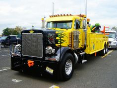 Yellow tow truck with flames...