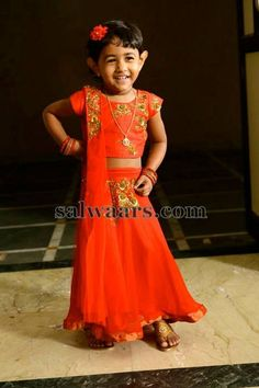 b43d9db30b41ae Baby in Orange Gagra Style Lehenga