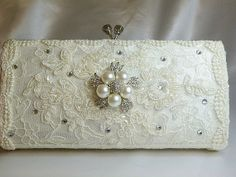 Lacey and twinkly wedding clutch bag .. vintage lace with Swarovski crystals and  pearls. $85.00, via Etsy.