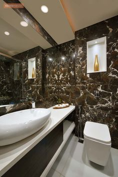 The Bathroom may seem smaller in comparison to other parts of the house but it is designed with rich Italian marble on the walls and pristine vitrified tiles on the floor along with a large mirror that makes it look bigger.