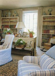 The library in the home of Nancy Lancaster, the late, legendary English country house interior designer. The library was created from an orangery, an outbuilding next to the coach house in which she lived during her last years. Her many books were housed in this stylish, yet comparatively modest space. Note the use of the tops of the bookcases to display sculpture, pottery and art. This is a well-known room to most interior designers.