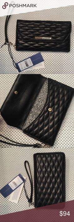 """Rebecca Minkoff Wristlet ♥︎ Rebecca Minkoff Wristlet in Quilted Black leather • Has gold hardware w/ zip top closure • Saffiano leather lining w/ optional wrist strap • Has an exterior snap-flap pocket, & an interior zip, smartphone, & money pockets (also has a spot for  6 credit cards) • Measures Approximately 7"""" x 4""""  MSRP $135 + tax   SOLD OUT  ♥︎no trades Rebecca Minkoff Bags Clutches & Wristlets"""