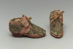Pair of children's shoes      Italian, 16th century       Italy  Dimensions      12.3 x 4.5 x 7.7 cm (4 13/16 x 1 3/4 x 3 1/16 in.)  Medium or Technique      Silk; satin with silk ribbon, gilt metal and spangle embroidery, gilt metal thread tassels, leather and parchment lining, and leather heel and sole  Classification      Costumes   Accession Number      43.1725a