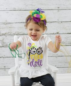 Our Mardi Doll shirt is perfect for your partying princess! Not only is this design super adorable, but we use a variety of different texture htv to make our product super special. This Mardi Gras design is put on a white ruffled bottom shirt for that extra shot of sweetness. Your little girl will be ready to catch beads in this shirt on Fat Tuesday!  The purchase of this listing is one shirt: Style: Short Sleeve, Ruffled bottom shirt  Materials: fine jersey raglan tee and htv  Sizes…