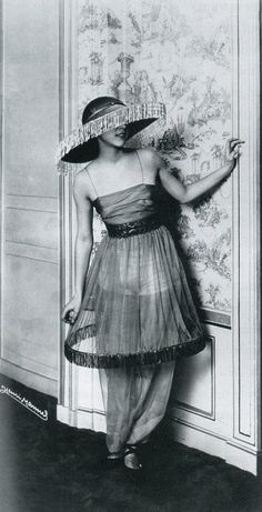 "Denise Poiret wife to Paul Poiret at the opening night of le minaret in one of his famous ""lampshade"" skirts 1913"
