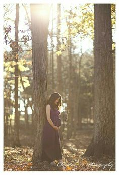 Whimsical forest maternity shoot