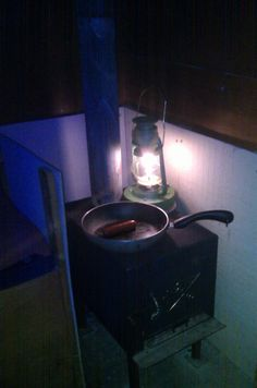 The Stove Lite Basic is a Wood Stove Thermoelectric Generator Lantern that lights up a room when placed on a wood stove. It's shown on an ice fishing shanty stove on Island Pond in Vermont. Ice Fishing Shanty, Thermoelectric Generator, Vermont, Light Up, Stove, Pond, Lanterns, Island, Wood Burning