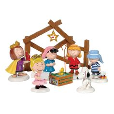 """Isn't this Christmas nativity set with Charlie Brown and the Peanuts gang just adorable?  Little Woodstock is in the manger, Snoopy is a sheep, and Charlie Brown and Linus are both shepherds. Sally is an angel, Peppermint Patty is a wise person, and Lucy is Mary. The """"kid"""" characters are all about three inches tall.  This would make a great Christmas gift as well as a nice centerpiece."""