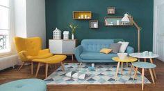 Salon scandinave mur vert bouteille