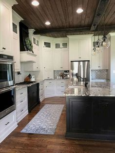 Black and White luxury kitchen cabinets, with dark wood ceiling. Awesome 40 Luxury White Kitchen Cabinets Ideas