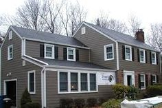 Image result for dark brown house with white windows vertical siding