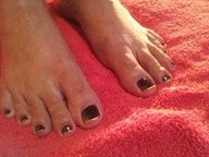 Black and gold toe nail design.