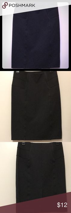 "Calvin Klein Black Skirt Calvin Klein Black Skirt like new black accents at waist dark Gray skirt  Rayon/nylon/spandex Length 22.5"" waist 28"" NICE pairing with multiple tops 7.5"" slit to back Skirt Slips On Calvin Klein Skirts"