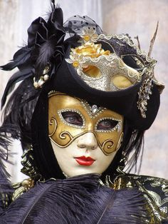Lovely lady with a small silver mask. Venice Carnival 2015 by Lesley McGibbon