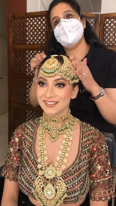 How pretty is this bride wearing an olive green lehenga with heavy embroidery work and bold mang teeka and passa with big latkans are a detail you cannot miss! (C) Parul Garg Makeup #wittyvows #indianwedding #indianweddinginspiration #weddingideas #bridalmakeup #bridallehenga #bridaljewellery #maangtikka #indianjewellery #indianbride Bridal Make Up, Bridal Looks, Bridal Accessories, Bridal Jewelry, Green Lehenga, Bride Getting Ready, Bridal Lehenga, Vows, Weddingideas