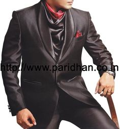 Cocktail party wear mens suit made in wine color polyester fabric. It has bottom as trouser made in wine color polyester fabric.