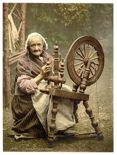 Irish spinner and spinning wheel. County Galway, Ireland - between ca. 1890 and ca. 1900.