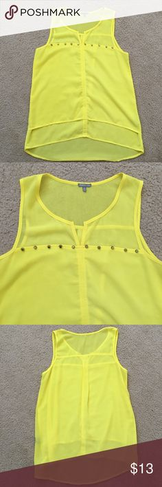 Studded yellow top •Bright yellow •100% polyester •Has some tarnishing on the sides of the studs as shown in the last pic  check out the FREE with purchase items Charlotte Russe Tops Tank Tops