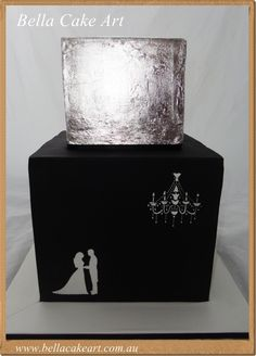 Black white and silver themed wedding cake by Bella Cake Art