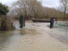 The Isis pouring through our front gates, during the flood of January 2014