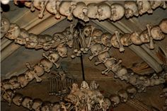 Sedlec Chapel,  Czech Republic.  Holds the remains of about 40,000 people. These bones were incorporated into the chapel as art and furnishings in 1870.
