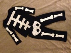 Homemade no-sew toddler skeleton costume. Easy and comfy! Glows in the dark!