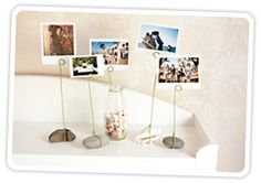 The DIY Stone Photo Holder: Make a Rad Photo Display for Under $5 , Idea for centerpiece at tea party, do this at dif. lengths with kids pics on flower shaped paper...leave for grandma!