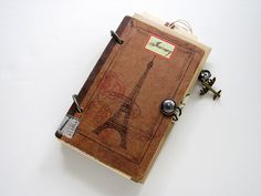 Vintage Inspired Travel Journal - front cover: used 7gypsies book covers and altered with label and multiple stamp images. added a vintage button and a rubber band for closure