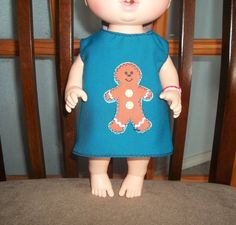 Baby 12 inch Alive doll handmade dress teal with a gingerbread cookie on it by sue18inchdollclothes on Etsy