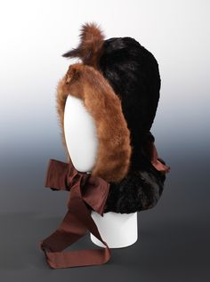 A fur bonnet from circa 1870. This looks incredibly cozy, and cute to boot!