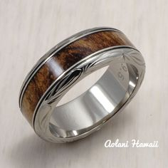Crafted with highly scratch-resistant(3 times harder than steel) titanium. This ring features resin sealed and water proof Hawaiian Koa Wood inlay in the center and polished finish metal surface. Hand