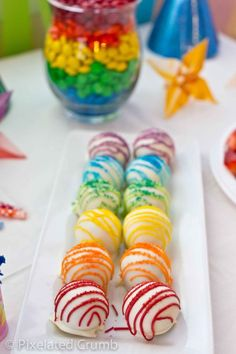 Creative Food: Rainbow Party.  Rainbow Cake balls  Visit www.partyzilla.com.au for Kids Party Supplies, Gifts and more!