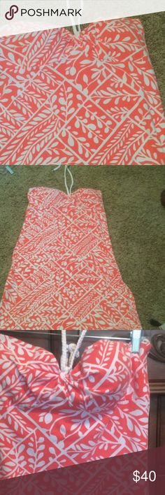 Beautiful floral tommy bahama sundress This sundress is stunning. Beautiful peachy/ coral color. Cute braided rope tie at neck. Never worn. Bought on posh. Too small Tommy Bahama Dresses Strapless