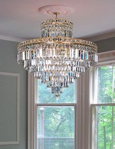 Rectangle shape droplets hanging from each circle frame and square trimmings dress the top main frame of the Beatrice flush mount crystal chandelier. She can be customized in any size, color or even shape in oval to make your place more shiny..