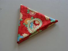 How to fold a fat quarter triangle.