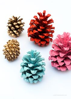 Spray paint pine cones to match your Thanksgiving or Christmas decorations. DIY. Could be a fun kid's craft if you use paint or glitter.