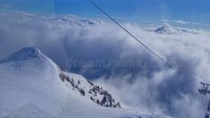 Photo about skiing clouds mountain heaven sky winter snow. Image of mountain, winter, snow - 111732170