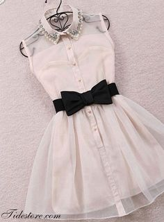 this dress is white it has Perls and a bow tie you can wear it any were .: