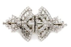 Diamond Double Clip-Brooch   Platinum, 112 diamonds ap. 3.25 cts., c. 1920, ap. 8.5 dwt.