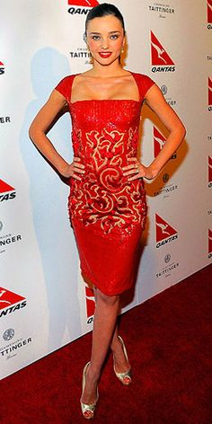 When doesn't this supermodel look fab? Donning a red arabesque, cap-sleeve Georges Chakra Couture dress, Miranda Kerr celebrates her new title as ambassador for Qantas Airways at their Spirit of Australia Party at the Hollywood Roosevelt Hotel on Thursday.She finishes off her look with gold peep-toe shoes by Alexandre Birman, makeup by Christy Coleman and earrings by Tresor.