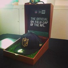 This is the New Era Cap that was available at the Super Bowl New Era Pop up shop. Its a Gold NFL logo on a solid black cap. Nice.