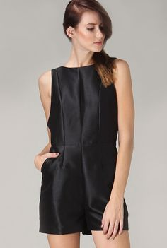 UNIQ 'Chateau de la Chevre d'Or' Romper - A sophisticated black one piece to enjoy some gin martinis at the Chateau de la Chevre d'Or. This fitted bodice romper features a high neck and side pockets. The keyhole cutout will highlight your sexy back as you sip your cocktails and look out over the cobblestone streets of the hilltop town of Eze. Available in Black. Imported.